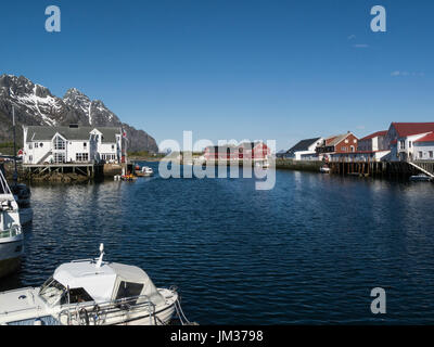 View of Henningsvær harbour of fishing village located on several small islands off the southern coast of Austvågøya - Stock Photo