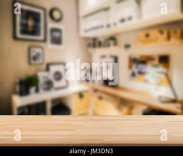 wooden countertop with workspace blurred background - Stock Photo