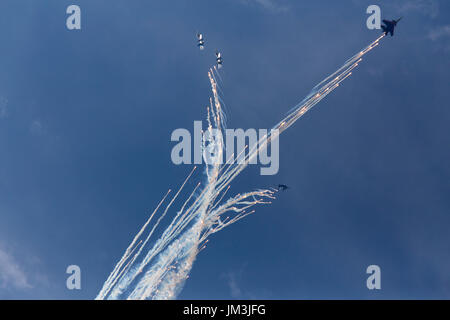 Military aircrafts making a stunt with fireworks. Russia, Moscow Airshow in July 2017 - Stock Photo