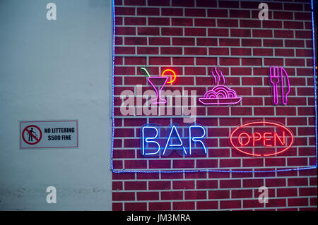 23.07.2017, Singapore, Republic of Singapore, Asia - Luminous advertising for a bar in Singapore's Chinatown district. - Stock Photo