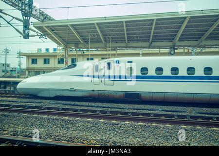 KYOTO, JAPAN - JULY 05, 2017: JR700 shinkansen bullet train departing Kyoto station in Kyoto, Japan - Stock Photo