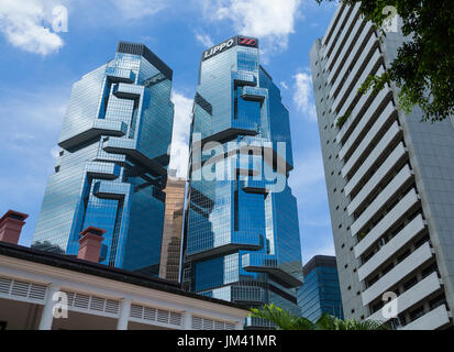 HONG KONG - JULY 16, 2014: Lippo Centre twin-tower skyscrapers. The Lippo Centre is a twin-towered office complex - Stock Photo