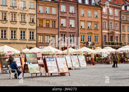 Warsaw, Poland - September 25, 2014: Paintings and pictures for sale on the Old Town Market Place square. - Stock Photo