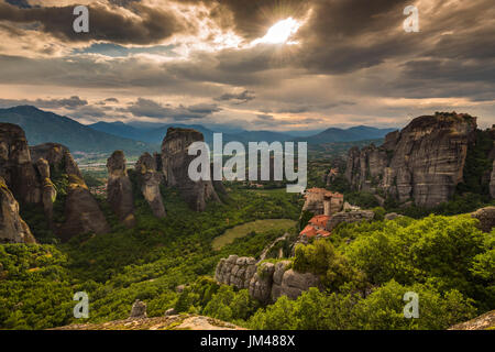 Sunset view over Monastery of Moni Agias Varvaras Roussanou and the spectacular massive rocky pinnacles of Meteora, - Stock Photo