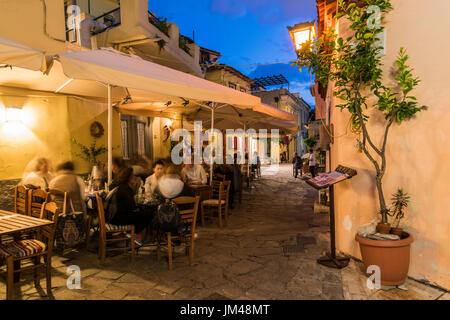 Night view of an outdoor cafe in the picturesque neighborhood of Anafiotika, Athens, Attica, Greece - Stock Photo