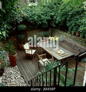 Outdoor table and chairs on deck - Stock Photo