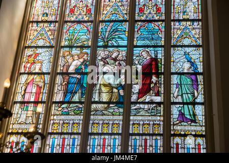 BRUGES, BELGIUM - MAY 26, 2017: The New Testament scenes on windowpane in St. Salvator's Cathedral (Salvatorskerk) - Stock Photo