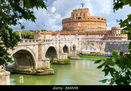 View of Sant Angelo fortress and bridge over Tiber river in Rome. Italy - Stock Photo