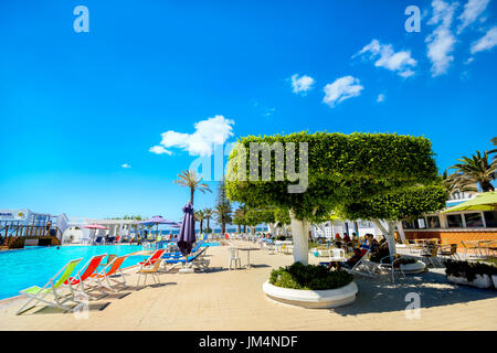 Courtyard with swimming pool of resort hotel on seaside in Nabeul. Tunisia, North Africa - Stock Photo