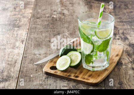 Mojito cocktail in glass on wooden table - Stock Photo