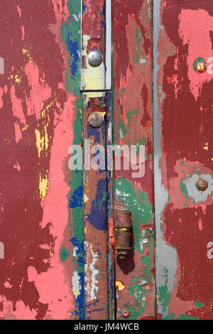 old painted door and hinges - Stock Photo