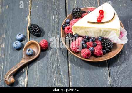 Dessert menu with berries in earthenware. Multicolored forest berries. - Stock Photo