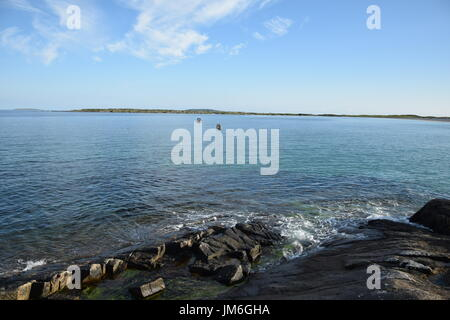 Bay with rocky coast next to Wild Atlantic Way in the County Galway, Ireland - Stock Photo