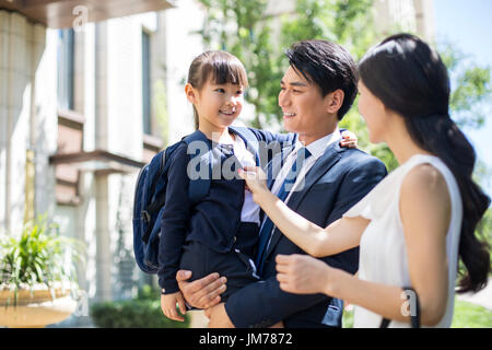 Chinese parents taking their child to school in the morning - Stock Photo