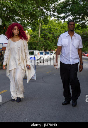Calm Expressions on this couple walking down the street. - Stock Photo