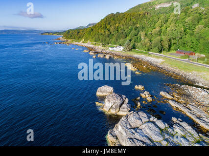 The eastern coast of Northern Ireland and Antrim Coastal Road, a.k.a. Causeway Coastal Route. Aerial view at sunrise - Stock Photo