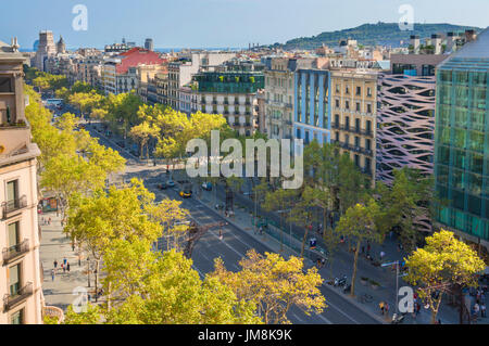 Barcelona Spain Catalunya Busy tree lined Passeig de Gracia avenue boulevard in the L'Eixample district of barcelona - Stock Photo