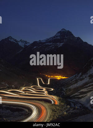 Vehicle light trails on Cuesta Caracoles Los Andes, the road to Portillo Ski resort and the Argentinian border: - Stock Photo