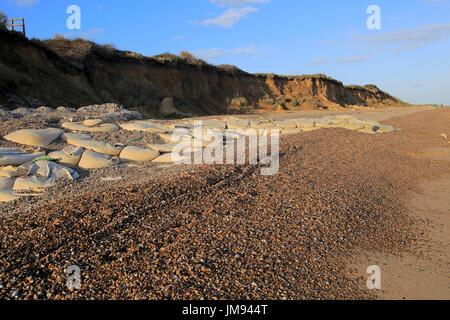 Sacks containing shingle form coastal defences at Thorpeness, Suffolk, England, UK - Stock Photo