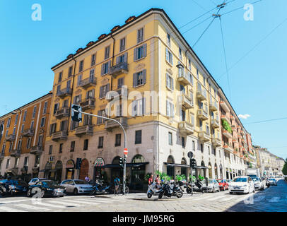 Milan, Italy - July 25th, 2017: A busy street corner in Milan, Italy during the summer - Stock Photo
