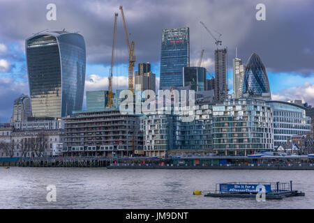 Tower cranes dominate the skyline as development in the heart of the city of London moves on at a pace. - Stock Photo
