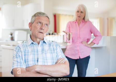 Senior Couple Having Argument At Home - Stock Photo