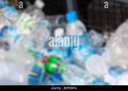 Blurred plastic bottles - Stock Photo