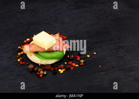 Homemade pancake canapes on slate stone plate for finger food party - Stock Photo