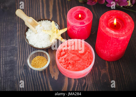 Candles and set of items for body care on a wooden background. The concept of relaxation and spa procedures. - Stock Photo