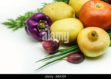 Assortment of fresh raw vegetables isolated on white background. Selection includes potato, tomato, green onion, - Stock Photo