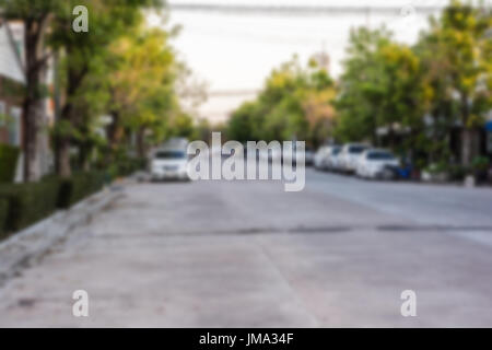 Blur image of road and house in the village for background usage with copy space. - Stock Photo