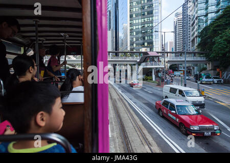 HONG KONG - OCTOBER 22, 2016: A double-storey-tram runs through a Causeway Bay street in Hong Kong, Central District. - Stock Photo