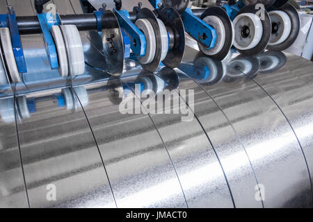 Galvanized steel strips processed on the slitting line - Stock Photo