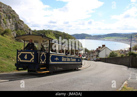 landscape view of a tram climbing the hill to great orme in llandudno - Stock Photo