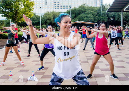 Houston, USA. 26th July, 2017. People take part in a Zumba class in Discovery Green, a public urban park in Downtown - Stock Photo