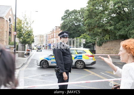 London, UK. 27th July, 2017. Stoke Newington Church Street and other roads closed by police near Abney Park Cemetery - Stock Photo