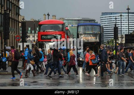 London, UK. 27th July, 2017. Heavy rain shower in Parliament Square. Credit: claire doherty/Alamy Live News - Stock Photo