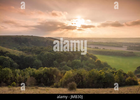 View of Old Winchester Hill in the South Downs National Park, Hampshire, in autumn at sunset - Stock Photo