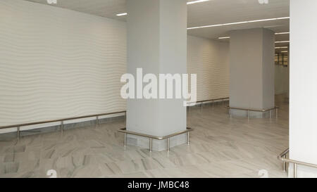 Interior empty office light room with white wallpaper without furniture in a new building - Stock Photo