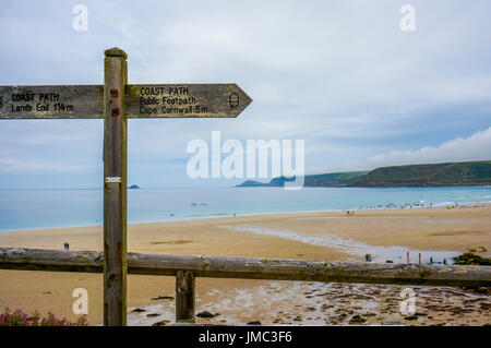 Coast path sign on beach - public footpath to Lands End, Cornwall, England, UK - Stock Photo