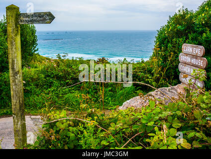 Public footpath to Nanquidno sign overlooking the sea, Cornwall, England, UK - Stock Photo