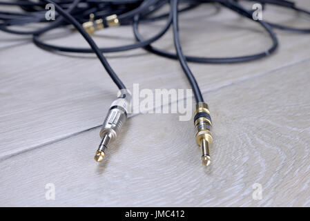 Generic guitar cables. - Stock Photo