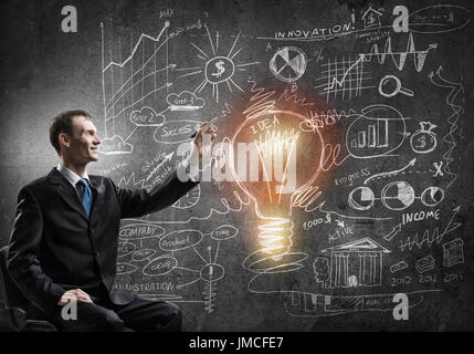 Businessman drawing business strategy - Stock Photo