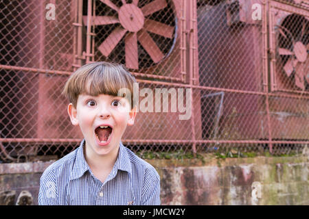 Silly little boy making funny face - Stock Photo