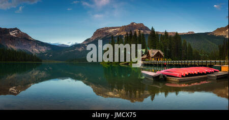 Canoes on beautiful Emerald Lake with lake lodge and restaurant in the background in Yoho National Park, British - Stock Photo
