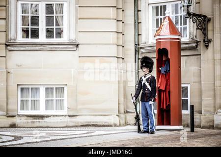 COPENHAGEN, DENMARK - JULY 20: Royal Life Guards at Amalienborg Palace, Copenhagen, Denmark - Stock Photo