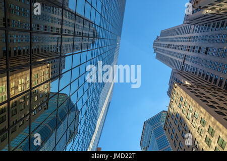 The Iconic Chrysler Building and its reflections in New York City, New York, USA - Stock Photo