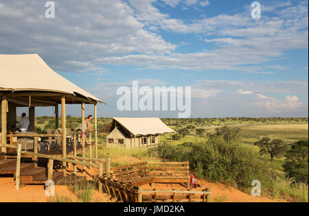 Lobby, fireplace and one of the stilted canvas tents of the Polentswa Camp on the ridge of a sand dune. During the - Stock Photo