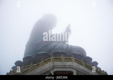 The enormous Tian Tan Buddha statue at high mountain near Po Lin Monastery, Lantau Island, Hong Kong - Stock Photo