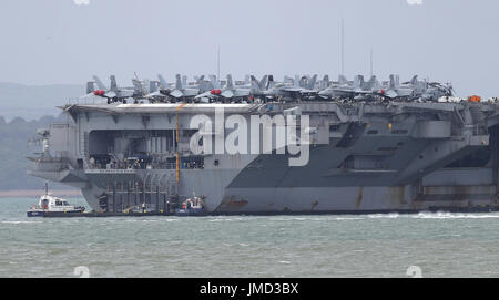Aircraft on the US Navy Nimitz-class aircraft carrier USS George H.W. Bush as it lays at anchor off the coastbefore - Stock Photo